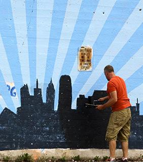 Artist Tony Passero at work on a mural.