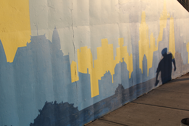Tony Passero Positive Babel Mural on Irving Park Road in Chicago Day 3 The Setting Sun Casts a Shadow on a Passerby