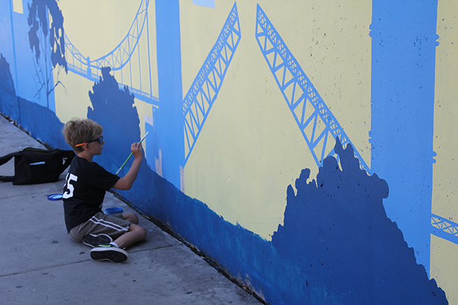 Tony Passero Positive Babel Mural on Irving Park Road in Chicago Day 5 Nico Working on Tower Bridge