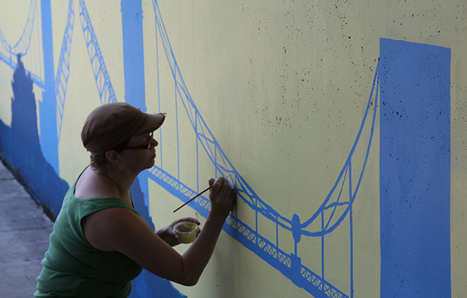 Tony Passero Positive Babel Mural on Irving Park Road in Chicago Day 6 Heather Working Details on the South Wall