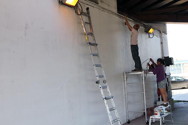 Tony Passero CrossCuts Mural on Addison Avenue Chicago Day 1 Drip Edge Install