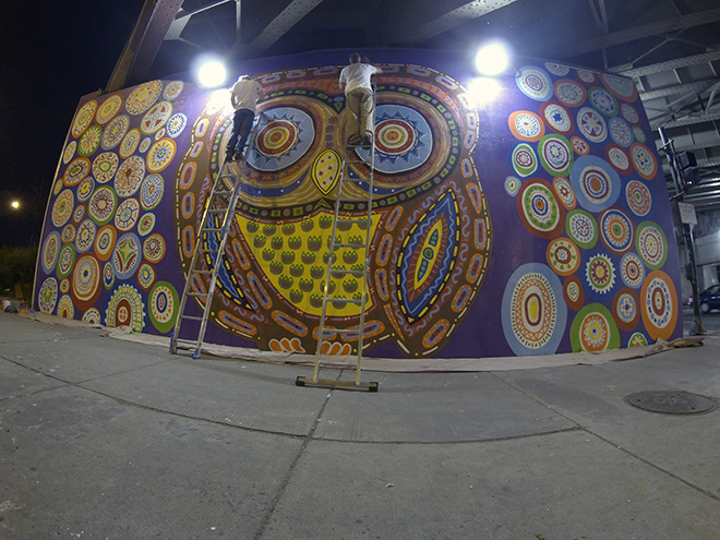 Tony Passero Whoot Owl Mural on Belmont and Kedzie in Chicago, IL Day 11 doing some high touch up on the owl