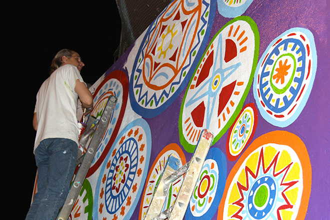 Tony Passero Whoot Owl Mural on Belmont and Kedzie in Chicago, IL Day 11 Jerry painting at the top of the mural