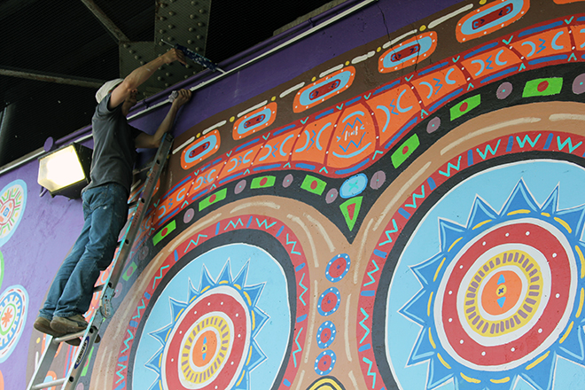 Tony Passero Whoot Owl Mural on Belmont and Kedzie in Chicago, IL Day 12 Jerry Runs a bead of caulk across the drip edge