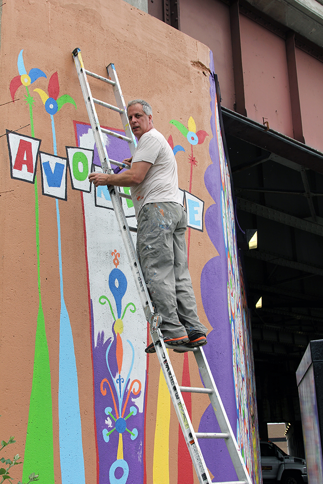 Tony Passero Painting in the Avondale Marker on the side wrap