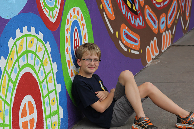 Tony Passero Whoot Owl Mural on Belmont and Kedzie in Chicago, IL Day 14 Nico hanging at what I hope is new public space for the Avondale community