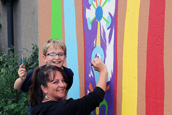 Tony Passero Whoot Owl Mural on Belmont and Kedzie in Chicago, IL Day 14 Nico and Shannon paint in the purple on the Avondale marker