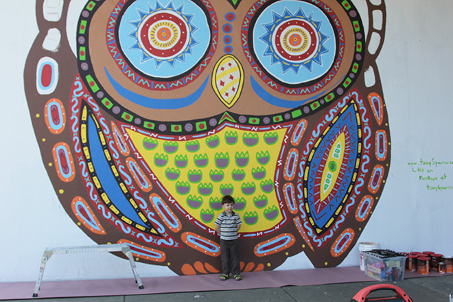 Tony Passero Whoot Owl Mural on Belmont and Kedzie in Chicago, IL Day 7 Logan stopped by with his dad Jim to root us on.