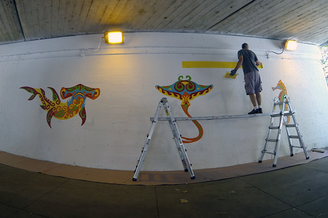 Tony Passero Coloribbean Mural in Rogers Park Chicago Day 3 Artist Tony Passero working in the first layer of the border