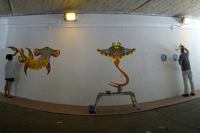 Shannon working with artist Tony Passero on the west end of the wall