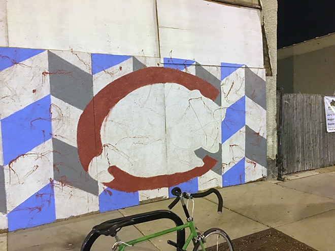 Tony Passero Chicago Cubs Mural Day 2 roughing in the red C in the walking bear logo on the left side