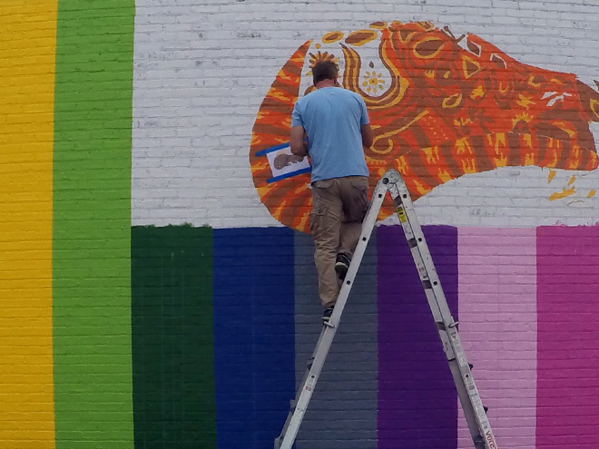 Tony Passero JagLeo Mural Day 3 Artist Tony Passero working on the mural's cat