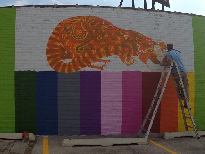 Tony Passero JagLeo Mural Day 3 Muralist Tony Passero working on the mural's cat