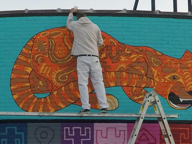 Tony Passero JagLeo Mural Day 6 Muralist Tony Passero working in detail