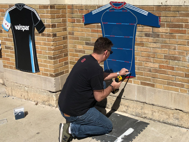 Tony Passero  Major League Soccer Chicago Fire Jersey Mural Installing a Jersey